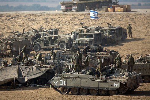http://warsclerotic.files.wordpress.com/2014/07/idf-troops-massing-on-border.jpg