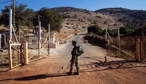 An Israeli soldier stands guard at a check point near the Lebanese-Israeli border, southern Lebanon
