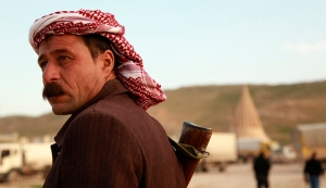A man from the minority Yazidi sect stands guard at Mount Sinjar, in the town of Sinjar
