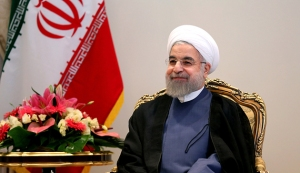 Iranian President Hassan Rouhani smiles during a meeting with German Economy and Energy Minister Sigmar Gabriel (unseen) in Tehran on July 20, 2015. Gabriel flew to Iran, becoming the first top Western official to visit the country since world powers and Tehran reached a historic nuclear deal. AFP PHOTO / ATTA KENARE (Photo credit should read ATTA KENARE/AFP/Getty Images)