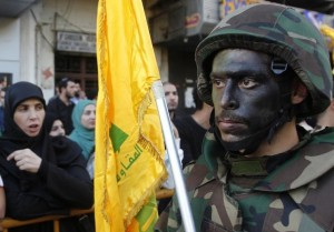 Lebanese Hezbollah supporters march during a religious procession, to mark the burning of the tents that is part of the Ashura religious ceremony, in Nabatieh
