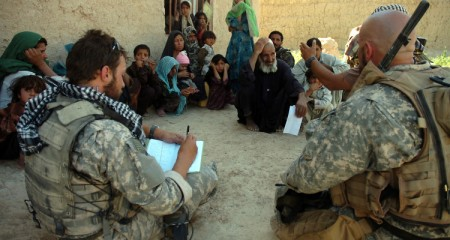 Special operations Soldiers listen to the complaints and stories of Afghan detainees at Farrah, Afghanistan May 27.