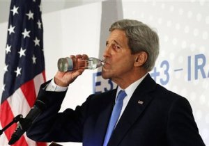 U.S. Secretary of State John Kerry takes a drink during a news conference after the closed-door nuclear talks with Iran, in Vienna, Austria, Monday, Nov. 24, 2014. Facing still significant differences between the U.S. and Iran, negotiators gave up on last-minute efforts to get a nuclear deal by the Monday deadline and extended their talks for another seven months. The move gives both sides breathing space to work out an agreement but may be badly received by domestic sceptics, since it extends more than a decade of diplomatic efforts to curb Iran's nuclear prowess. (AP Photo/Ronald Zak)