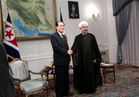 Iranian President Hasan Rouhani, right, shakes hands with a top North Korean leader, Kim Yong Nam, at the start of a meeting in Tehran, Iran, Saturday, Aug. 3, 2013. Iran's supreme leader formally endorsed Hasan Rouhani as president Saturday, allowing the moderate cleric to take charge of a country weakened by economic sanctions over its nuclear program. Kim Yong Nam is in Tehran to attend a ceremony when Rouhani will take the oath of office in parliament Sunday. (AP Photo/Ebrahim Noroozi)