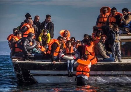 Refugees from Syria and Iraq disembark on the Greek island of Lesbos after arriving with other 120 people on a wooden boat from the Turkish coast, Monday, Oct. 26, 2015. Greeceís government says it is preparing a rent-assistance program to cope with a growing number of refugees, who face the oncoming winter and mounting resistance in Europe.(AP Photo/Santi Palacios)