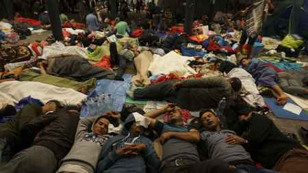 syrian_refugees_having_rest_at_the_floor_of_keleti_railway_station._refugee_crisis._budapest_hungary_central_europe_5_september_2015