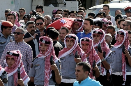 """Jordanian mourners carry the body of intelligence corporal Omar al-Hayari, one of the five Jordanian intelligence agents killed during a gun attack at the Palestinian refugee camp of Baqaa, on June 6, 2016 during his funeral in Salt, a town west of the capital Amman. A gunman apparently acting alone killed the five Jordanian agents in a daylight """"terrorist attack"""" on their office in a Palestinian refugee camp north of the capital. Jordan is a leading member of the US-led coalition fighting the Islamic State group in neighbouring Iraq and Syria, and has been the target of previous jihadist attacks. / AFP PHOTO / KHALIL MAZRAAWI"""