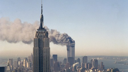 """FILE - In this Sept. 11, 2001 file photo the twin towers of the World Trade Center burn behind the Empire State Building in New York after terrorists crashed two planes into the towers causing both to collapse. The government is preparing to release a once-classified chapter of a congressional report about the attacks of Sept. 11, that questions whether Saudi nationals who helped the hijackers with things like finding apartments and opening bank accounts knew what they were planning. House Minority Leader Nancy Pelosi said Friday July 15, 2016, that the release of the 28-page chapter is """"imminent."""" (AP Photo/Marty Lederhandler)"""