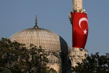 A Turkish flag is seen next to the dome of Hagia Sophia mosque in Istanbul, Turkey, July 16, 2016. REUTERS/Alkis Konstantinidis