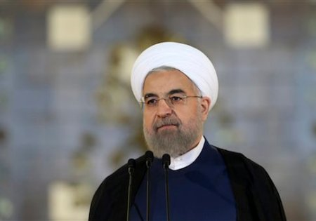 "Iran's President Hassan Rouhani addresses the nation in a televised speech after a nuclear agreement was announced in Vienna, in Tehran, Iran, Tuesday, July 14, 2015. Rouhani said ""a new chapter"" has begun in his nation's relations with the world. He maintained that Iran had never sought to build a bomb, an assertion the U.S. and its partners have long disputed. (AP Photo/Ebrahim Noroozi)"