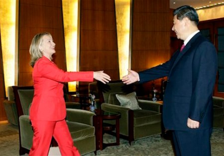 U.S. Secretary of State Hillary Clinton, left, prepares to shake hands with China's Vice President Xi Jinping during a meeting at Diaoyutai State Guesthouse in Beijing, Thursday, May 3, 2012. (AP Photo/Jason Lee, Pool)