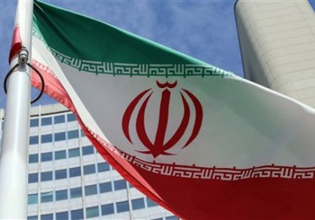 An Iranian flag flies in front of the building where closed-door nuclear talks take place in Vienna, Austria, Wednesday, July 2, 2014. (AP Photo/Ronald Zak)