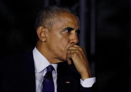 President Barack Obama pauses during a discussion with actor Leonardo DiCaprio and Dr. Katharine Hayhoe about climate change as part of the White House South by South Lawn event on the South Lawn of the White House in Washington, Monday, Oct. 3, 2016. (AP Photo/Carolyn Kaster)