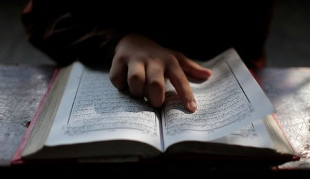 A Bangladeshi Muslim student reads the holy Quran at an Islamic school during Ramadan in Dhaka, Bangladesh, Wednesday, June 29, 2016. Muslims throughout the world are marking the holy month of Ramadan, during which they fast from dawn till dusk. (AP Photo/A.M. Ahad)