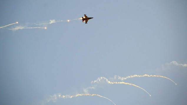 An Israel Air Force F-16 fighter jet fires off flares during a demonstration on December 31, 2015. (Hagar Amibar/Israel Air Force/Flickr)