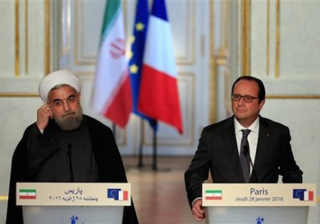 France's President Francois Hollande, right, and Iranian President Hassan Rouhani give a press conference, at the Elysee Palace, in Paris, Thursday, Jan. 28, 2016. Iran Air has signed a deal to buy 118 aircraft from Airbus in the first of an expected host of commercial deals expected to be announced during the visit of Iranian President Hassan Rouhani to Paris. (AP Photo/Thibault Camus)