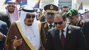 In this March 28, 2015 file photo provided by Egypt's state news agency MENA, Egyptian President Abdel-Fattah el-Sissi, right, talks with Saudi King Salman after the king arrives in Sharm el-Sheikh, in the southern Sinai. (MENA via AP, File)