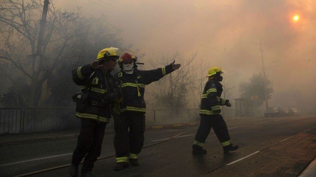 Firefighters battle wildfires in Haifa, Thursday, Nov. 24, 2016. (AP Photo/Ariel Schalit)