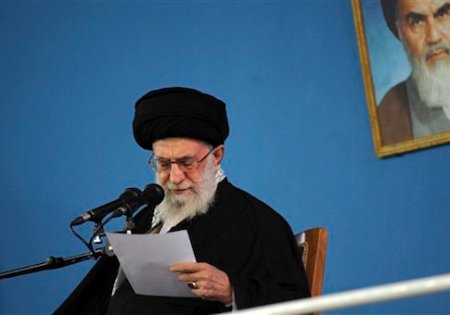 "In this picture released by the official website of the office of the Iranian supreme leader, Supreme Leader Ayatollah Ali Khamenei reads a note during his speech in a public gathering at his residence in Tehran, Iran, Wednesday, Jan. 7, 2015. Iran's supreme leader said Wednesday the United States cannot be trusted to lift sanctions in a future nuclear deal and that Tehran should instead develop an ""economy of resistance."" A portrait of the late revolutionary founder Ayatollah Khomeini hangs in background. (AP Photo/Office of the Iranian Supreme Leader)"