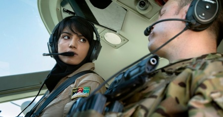 Afghan air force 2nd Lt. Niloofar Rhmani and Capt. Aaron Marx preflight a Cessna 208 at Kabul International Airport, Afghanistan. On this day, Rhmani became the first woman to fly a fixed wing combat mission. Marx hails from San Antonio, Texas, and is deployed from RAF Mildenhall, England, were he pilots KC-135R Stratotankers. (U.S. Air Force photo/Master Sgt. Ben Bloker)