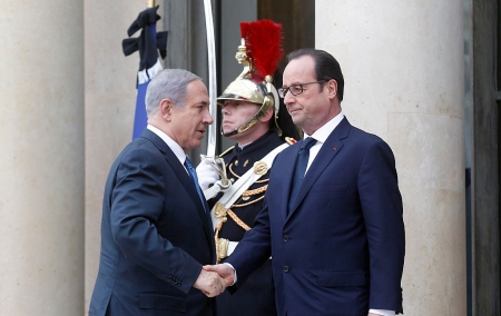 PARIS, FRANCE - JANUARY 11: French President Francois Hollande (R) welcomes Israeli Prime Minister Benjamin Netanyahu at the Elysee Palace before attending a Unity rally in tribute to the 17 victims of a three-day killing spree by homegrown Islamists on January 11, 2015 in Paris, France. A mass unity rally to be held in Paris following the recent terrorist attacks on January 11, 2015 in Paris, France. An estimated one million people are expected to converge in central Paris for the Unity March joining in solidarity with the 17 victims of this week's terrorist attacks in the country. French President Francois Hollande will lead the march and will be joined by world leaders in a sign of unity. The terrorist atrocities started on Wednesday with the attack on the French satirical magazine Charlie Hebdo, killing 12, and ended on Friday with sieges at a printing company in Dammartin en Goele and a Kosher supermarket in Paris with four hostages and three suspects being killed. A fourth suspect, Hayat Boumeddiene, 26, escaped and is wanted in connection with the murder of a policewoman. (Photo by Thierry Chesnot/Getty Images)