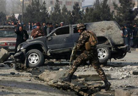 Afghan security personnel inspect at the site of roadside bomb blast in Kabul, Afghanistan, Wednesday, Dec. 28, 2016. Afghan officials say that at least three people have been wounded by a roadside bomb blast in the capital, Kabul. (AP Photo/Rahmat Gul)