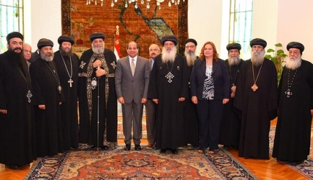 Egyptian President Abdel Fattah al-Sisi attends a meeting with Egyptian Coptic Pope Tawadros II, head of the Egyptian Coptic Orthodox Church, with some members of the Holy Synod of the Coptic Orthodox Church at the Ittihadiya presidential palace in Cairo, Egypt July 28, 2016 in this handout picture courtesy of the Egyptian Presidency. The Egyptian Presidency/Handout via REUTERS ATTENTION EDITORS - THIS IMAGE WAS PROVIDED BY A THIRD PARTY. EDITORIAL USE ONLY. - RTSK39U