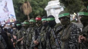 Members of the Izz ad Din al-Qassam Brigades, Hamass military wing, take part in a ceremony, on December 18, 2016, in Gaza City in the memory of one of their leaders, Mohamed Zaouari, who was murdered in Tunisia. (AFP/Mahmud Hams)