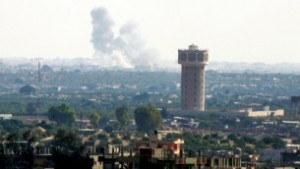 Illustrative: smoke rises after an airstrike in the Sinai city of Rafah as seen from Gaza on July 1, 2015. (Abed Rahim Khatib/Flash90)
