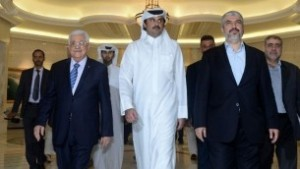 Palestinian Authority President Mahmud Abbas with Emir of Qatar Sheikh Tamim Bin Hamad al-Thani and Hamas leader Khaled Mashaal in Doha on August 21, 2014. (photo credit: AFP PHOTO/ PPO / THAER GHANEM)