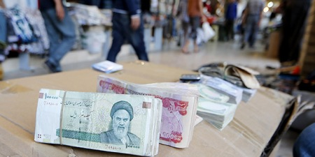 Iranian rial banknotes bearing a portrait of the late founder of the Islamic Republic of Iran, Ayatollah Ruhollah Khomeini, sit on the stand of an Iraqi money dealer on June 19, 2014, in Arbil, the capital of the autonomous Kurdish region of northern Iraq. President Hassan Rouhani said on June 18 Iran would do whatever it takes to protect revered Shiite shrines in Iraq against Sunni militants fighting the Baghdad government. AFP PHOTO/KARIM SAHIB (Photo credit should read KARIM SAHIB/AFP/Getty Images)