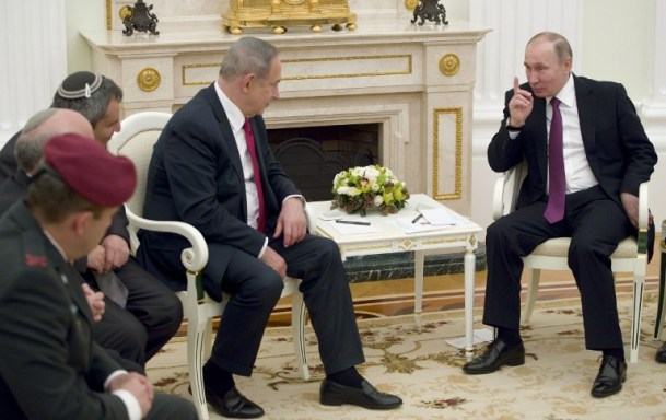 Russian President Vladimir Putin, right, speaks with Prime Minister Benjamin Netanyahu during their meeting in Moscow on March 9, 2017. (AFP/Pool/Pavel Golovkin)