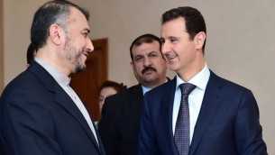 Syrian President Bashar Assad, right, speaks with Iran's Deputy Foreign Minister Hossein Amir Abdollahian, left, in Damascus, Syria, Thursday, Sept. 3, 2015 (Syrian presidency Facebook page)