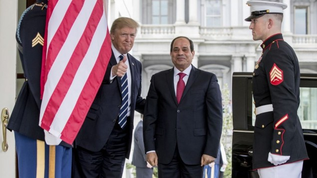 President Donald Trump gives a thumbs up to members of the media as he greets Egyptian President Abdel Fattah el-Sissi at the White House in Washington, Monday, April 3, 2017. (AP Photo/Andrew Harnik)