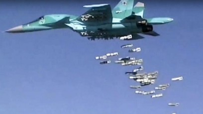 Image made from video provided by the Russian Defense Ministry press service on August 18, 2016, shows a Russian combat fighter bomber Su-34 unload its bombs over a target in Syria. (Russian Defense Ministry Press Service photo via AP, File)