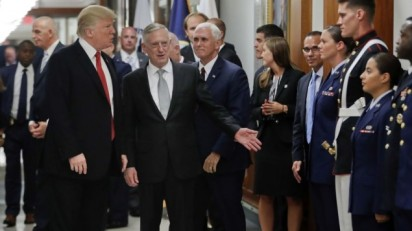 President Donald Trump and Vice President Mike Pence walk with Defense Secretary Jim Mattis, center, to begin greeting military personnel during their visit to the Pentagon, Thursday, July 20, 2017. (AP Photo/Pablo Martinez Monsivais)