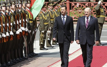 Belarus President Alexander Lukashenko, right, and his Syrian counterpart Bashar Assad are seen during a meeting in Minsk, Belarus, Monday, July 26, 2010. (AP/Nikolai Petrov, BelTA)