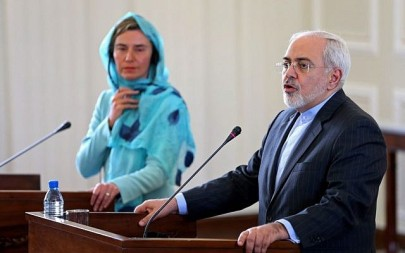 File: Iranian Foreign Minister Mohammad Javad Zarif, right, and the European Union foreign policy chief Federica Mogherini arrive to attend a press briefing after their meeting, in Tehran, Iran, Saturday, April 16, 2016.  (AP/Ebrahim Noroozi)