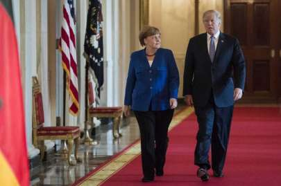 President Donald Trump arrives with German Chancellor Angela Merkel on Friday for a joint news conference in the East Room of the White House. Photo: Washington Post Photo By Jabin Botsford / The Washington Post