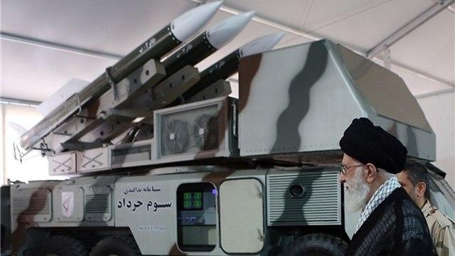 Supreme Leader Ayatollah Ali Khamenei examining the system