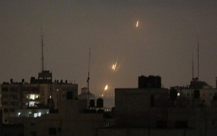 Flames from  rockets fired by Palestinians are seen over Gaza Strip heading toward Israel , early Wednesday, May 30, 2018. (AP Photo/Hatem Moussa)