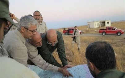 This file photo provided on Friday October 20, 2017 by the government-controlled Syrian Central Military Media, shows Iran's army chief of staff Maj. Gen. Mohammad Bagheri, left, looking at a map with senior officers from the Iranian military as they visit a front line in the northern province of Aleppo, Syria. (Syrian Central Military Media, via AP, File)