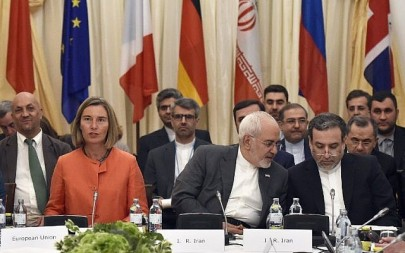 European Union High Representative for Foreign Affairs Federica Mogherini, left, and  Iranian Minister of Foreign Affairs Mohammad Javad Zarif, center, take part in a Comprehensive Plan of Action (JCPOA) ministerial meeting on the Iran nuclear deal on July 6, 2018 in Vienna, Austria. (AFP/APA/Hans Punz)