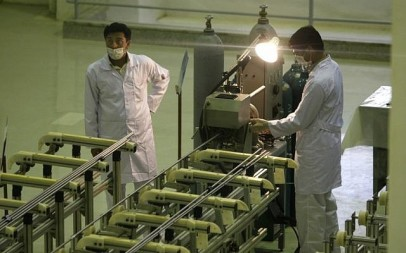 Iranian technicians work at a facility producing uranium fuel for a planned heavy-water nuclear reactor, outside Isfahan, 255 miles (410 kilometers) south of the capital Tehran, in 2009. (photo credit: AP/Vahid Salemi)
