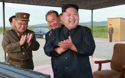 In this undated file photo distributed on September 16, 2017 by the North Korean government, North Korean leader Kim Jong Un, right, celebrates what was said to be the test launch of an intermediate range Hwasong-12 missile at an undisclosed location in North Korea.  (Korean Central News Agency/Korea News Service via AP)