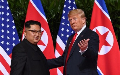 US President Donald Trump (R) gestures as he meets with North Korea's leader Kim Jong Un (L) at the start of their historic US-North Korea summit, at the Capella Hotel on Sentosa island in Singapore on June 12, 2018. (AFP/Saul Loeb)