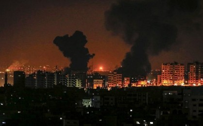 A picture taken on August 8, 2018 in Gaza City shows smoke plumes rising following an Israeli air strike. (AFP/MAHMUD HAMS)