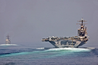 The guided-missile cruiser USS Cape St. George (CG 71) and the aircraft carrier USS Abraham Lincoln (CVN 72) transit the Strait of Hormuz (photo credit: CC BY Official U.S. Navy Imagery)
