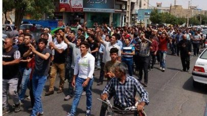Iranians take to the street in protest against economic hardships