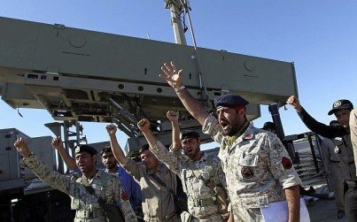 Iranian navy personnel celebrate after successfully launching a Ghader missile from the Jask port area on the shores of the Gulf of Oman during a drill near the Strait of Hormuz, Tuesday, January 1, 2013. (AP/Jamejam Online, Azin Haghighi)